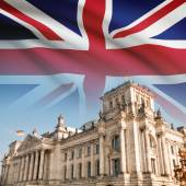 Reichstag (Bundestag) building in Berlin with flag on background - Great Britain — Stock Photo