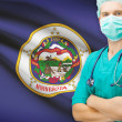 Surgeon with US state flag on background series - Minnesota — Stock Photo #70852045