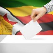 Ballot box with national flag on background - Zimbabwe — Stock Photo