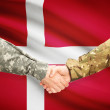 Men in uniform shaking hands with flag on background - Denmark — Stock Photo #71988007