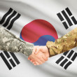 Men in uniform shaking hands with flag on background - South Korea — Stock Photo #71988501