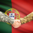 Men in uniform shaking hands with flag on background - Portugal — Stock Photo #71988659