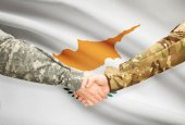 Men in uniform shaking hands with flag on background - Cyprus — Stock Photo