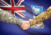 Men in uniform shaking hands with flag on background - Falkland Islands — Stock Photo