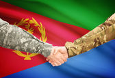Men in uniform shaking hands with flag on background - Eritrea — Stock Photo