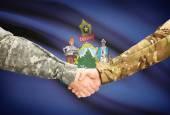 Military handshake and US state flag - Maine — Stock Photo