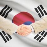 Businessmen handshake with flag on background - South Korea — Stock Photo #72711001