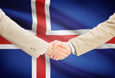Businessmen handshake with flag on background - Iceland — Stock Photo