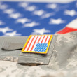 New USA army uniform over flag - focus on stripe — Stock Photo #73645085
