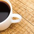 Cup of black coffee on old wooden table - view from top — Stock Photo #73645149