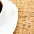 Cup of black coffee on old wooden table - shot from top — Stock Photo #73645157
