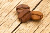 Coffee beans on old table - close up shot — Stock Photo