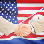 Businessmen handshake - United States and North Korea — Stock Photo #74160747