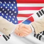 Businessmen handshake - United States and South Korea — Stock Photo #74160893