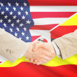 Businessmen handshake - United States and Uganda — Stock Photo #74161019