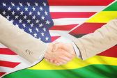 Businessmen handshake - United States and Zimbabwe — Stock Photo