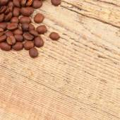 Coffee beans spread over table - close up shot — Stock Photo