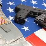 Handgun over US flag - close up studio shoot — Stock Photo #76390593