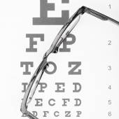 Eyesight test table with glasses over it - close up — Stock Photo