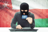 Concept of cybercrime with national flag on background - Oman — Stock Photo