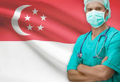 Surgeon with flag on background series - Singapore — Stock Photo