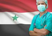 Surgeon with flag on background series - Syria — Stock Photo