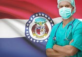 Surgeon with US states flags on background series - Missouri — Stock Photo
