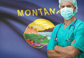 Surgeon with US states flags on background series - Montana — Stock Photo