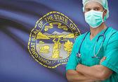 Surgeon with US states flags on background series - Nebraska — Stok fotoğraf