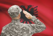 Soldier in hat facing national flag series - Albania — Stock Photo