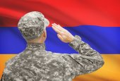 Soldier in hat facing national flag series - Armenia — Stock Photo