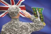 Soldier in hat facing national flag series - British Virgin Islands — Stock Photo