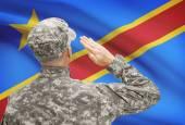 Soldier in hat facing national flag series - Congo-Kinshasa — Stock Photo