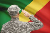Soldier in hat facing national flag series - Congo-Brazzaville — Stock Photo