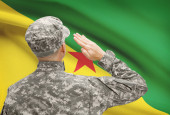Soldier in hat facing national flag series - French Guiana — Stock Photo