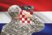 Soldier in hat facing national flag series - Croatia — Stock Photo