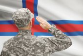 Soldier in hat facing national flag series - Faroe Islands — Stock Photo