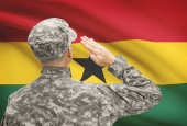 Soldier in hat facing national flag series - Ghana — Stock Photo