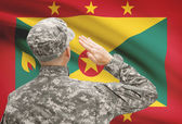 Soldier in hat facing national flag series - Grenada — Stock Photo