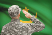 Soldier in hat facing national flag series - Mauritania — Stock Photo