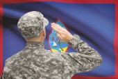 Soldier in hat facing national flag series - Guam — Stock Photo