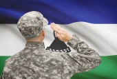 Soldier in hat facing national flag series - Lesotho — Stock Photo