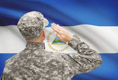 Soldier in hat facing national flag series - Nicaragua — Stock Photo