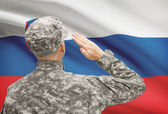 Soldier in hat facing national flag series - Slovenia — Stock Photo