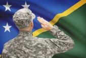 Soldier in hat facing national flag series - Solomon Islands — Stock Photo
