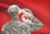 Soldier in hat facing national flag series - Tunisia — Stock Photo