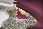 Soldier in hat facing national flag series - Qatar — Stock Photo