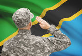 Soldier in hat facing national flag series - Tanzania — Stock Photo