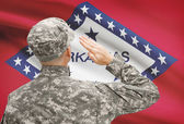 Soldier saluting to US state flag series - Arkansas — Stock Photo