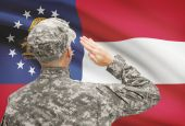 Soldier saluting to US state flag series - Georgia — Stock Photo